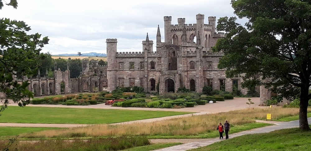 Two visitors walking the grounds of Lowther Castle.